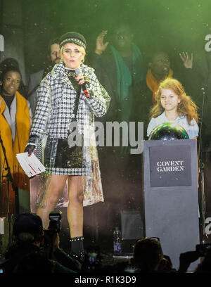 Covent Garden, London, UK, 13th Nov 2018, Paloma Faith switches on the Covent Garden Christmas lights in the iconic Piazza, while The Kingdom Choir and the company of RSC's Matilda The Musical entertained the crowd. Covent Garden gets a sprinkling of November snow with lots of (fake) snow coming down on hundreds of spectators who have turned up. Credit: Imageplotter News and Sports/Alamy Live News - Stock Photo
