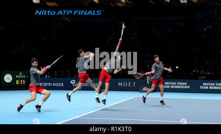 London, UK. 13th Nov, 2018. Day 3, Nitto ATP World Tour Finals 2018.  LONDON, ENGLAND - NOVEMBER 13: (Editors note, edited multiple exposure) Dominic Thiem of Austria in action during his singles match against Roger Federer of Switzerland on day three of the ATP World Tour Finals at the O2 Arena on November 13, 2018 in London, England. Photo by Paul Cunningham Credit: Paul Cunningham/Alamy Live News - Stock Photo