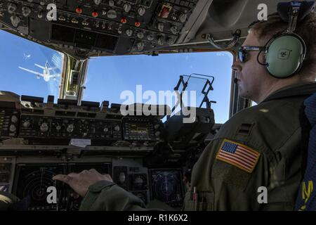 U.S. Air Force Capt. Cameron A. Hatton, a C-17 Globemaster III pilot with the 732nd Airlift Squadron, 514th Air Mobility Wing, maneuvers in to be refueled by a KC-10 Extender crewed by Reserve Citizen Airmen with the 514th's 78th Air Refueling Squadron during a joint training mission with the 514th Aeromedical Evacuation Squadron (AES), 45th AES, and the 439th AES over the United States Oct. 5, 2018. The 514th is an Air Force Reserve Command unit at Joint Base McGuire-Dix-Lakehurst, N.J. The 45th and the 439th AES are Air Force Reserve Command units from MacDill Air Force Base, Fla., and Westo - Stock Photo