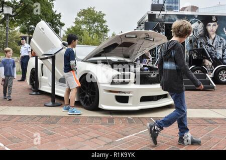 Local Maryland children inspect the Ford Mustang (X-1) during Fleet Week October 6, 2018 in Baltimore, Md. The X-1 is part of an Air Force Recruiting Service 2009 Super Car Tour recruiting initiative that kicked off in May of 2009. - Stock Photo
