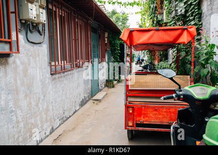 Chinese old street Hutong and rickshaw at Shichahai in Beijing, China - Stock Photo