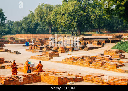 Varanasi, India - November 23, 2017 : Sarnath ancient ruins and monks - Stock Photo