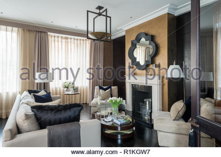 Masculine style living room with fireplace - Stock Photo
