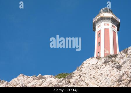 Capri, Italy. Pink and white lighthouse of Punta Carena on the south western coast of Capri, Amalfi Coast, Italy.