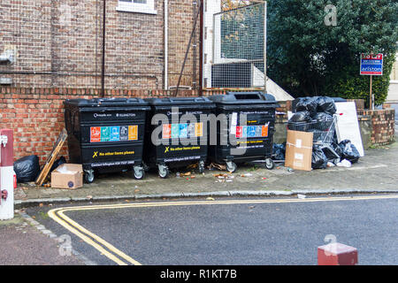 Overflowing recycling bins and dumped rubbish in Islington, London, UK - Stock Photo