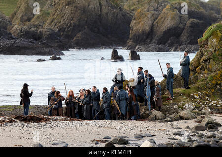 Tourists wearing costumes holding swords on a Game of Thrones guided