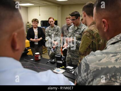 U.S. Air Force Airman Trent Olson, 85th Engineering Installation Squadron cable and antenna systems technician, conducts a cable splicing demonstration during an open house inside Maltby Hall at Keesler Air Force Base, Mississippi, Oct. 11, 2018. Keesler leadership and personnel attended the event to become more familiar with the 85th EIS mission capabilities. - Stock Photo