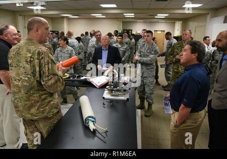 U.S. Air Force Tech. Sgt. Michael Williams, 85th Engineering Installation Squadron project engineering NCO in charge, briefs on fiber optic cable equipment during an open house inside Maltby Hall at Keesler Air Force Base, Mississippi, Oct. 11, 2018. Keesler leadership and personnel attended the event to become more familiar with the 85th EIS mission capabilities. - Stock Photo