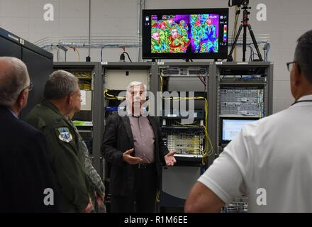 Randal Blanchard, 85th Engineering Installation Squadron senior electronics engineer, briefs on the telecommunications lab capabilities during the 85th EIS open house inside the Annex building at Keesler Air Force Base, Mississippi, Oct. 11, 2018. Keesler leadership and personnel attended the event to become more familiar with the 85th EIS mission capabilities. - Stock Photo