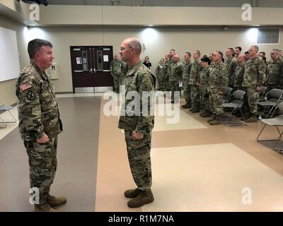 Sgt. Maj. Peter Running, right, the former command sergeant major of United States Army Civil Affairs and Psychological Operations Command (Airborne), reports to Maj. Gen. Darrell Guthrie, USACAPOC(A) commanding general, before being awarded a legion of Merit for his time as senior enlisted leader Saturday, October 20, 2018 at the USACAPOC(A) headquarters on Fort Bragg. Running left his position at USACAPOC(A) to become the senior enlisted advisor for Lt. Gen. Charles Luckey's Commander's Action Group at the Office of the Chief of the Army Reserve in Washington, D.C. ( - Stock Photo