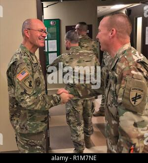 Sgt. Maj. Peter Running, right, the former command sergeant major of United States Army Civil Affairs and Psychological Operations Command (Airborne), speaks to a group of USACAPOC(A) Soldiers after being awarded a legion of Merit for his time as senior enlisted leader Saturday, October 20, 2018 at the USACAPOC(A) headquarters on Fort Bragg. Running left his position at USACAPOC(A) to become the senior enlisted advisor for Lt. Gen. Charles Luckey's Commander's Action Group at the Office of the Chief of the Army Reserve in Washington, D.C. ( - Stock Photo