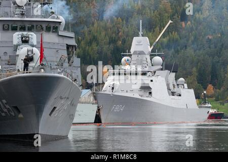 Trondheim (NORWAY) , Oct. 21. 2018. Standing NATO Maritme Group Two (SNMG2) ships, TCG Orucreis (F245) and flagship HNLMS De Ruyter (F804) are berthed alongside in Trondheim harbour prior their participation to NATO exercise Trident Juncture 2018. Trident Juncture 18 is designed to ensure that NATO forces are trained, able to operate together and ready to respond to any threat from any direction. Trident Juncture 18 takes place in Norway and the surrounding areas of the North Atlantic and the Baltic Sea, including Iceland and the airspace of Finland and Sweden.     With more than 50,000 partic - Stock Photo