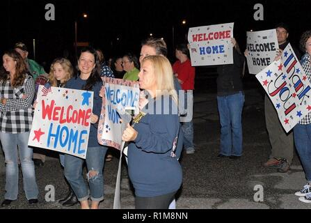 WWII through Vietnam Era veterans are welcomed back at the conclusion of a bus trip organized by Honor Flight Historic Triangle Virginia. Uniformed Service Members from area commands, and members of the public were on-hand with signs, applauses, and smiles to welcome the bus convoy back after a day trip to Washington, DC. This group, part of Honor Flight Historic Triangle Virginia's Mission 20, took veterans to the National Museum of the Marine Corps, Arlington National Cemetery, and the Korean War/Vietnam War Memorial. - Stock Photo