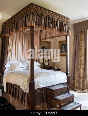 Brown and white canopy bed - Stock Photo