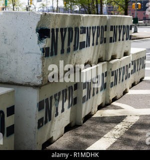 Concrete blocks on road, New York City, New York State, USA - Stock Photo
