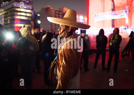 Mexico City, MEXICO - December 6: A man dressed as a Zapata joins students, protestors and family of 43 missing students from Guerrero State in Mexico. Protestors marched through Mexico City to protest the government and demand answers of the missing students, December 6, 2014. The students have been missing since September 26, 2014 and are from the Ayotzinapa teaching college near Chilpancingo, Guerrero, Mexico. - Stock Photo