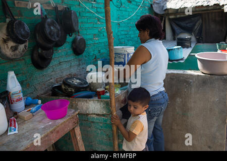 Bertha Moreno Garcia washes dishes outside of her house in Iguala, Guerrero, Mexico, February 6, 2016. Moreno Garcia's son Jose Manuel Cruz Moreno was last seen January 2, 2009 from a small community on the outskirts of Iguala. He was 22 years old.   Jose Manuel left the house, telling his mother he was going to buy new shoes and then go to a party celebrating the anniversary of a Colonia. His younger brother saw him drunk that night, that was the last time he was seen.   ÒIt is very heavy for me,Ó said Bertha. ÒWe went to search, we went to the hospital, we went to the jail, the Colonia he we - Stock Photo