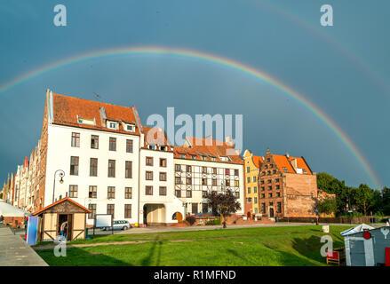 Rainbow above Elblag town in Poland - Stock Photo