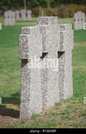 close up view of identical memorial stone crosses placed in row at cemetery - Stock Photo