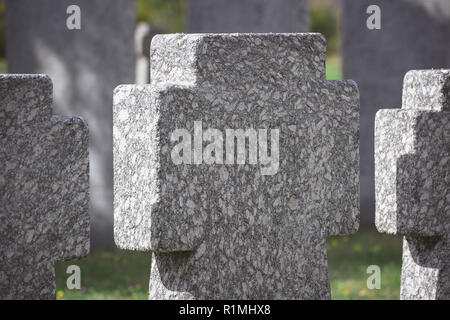 close up view of memorial stone crosses placed in row at graveyard - Stock Photo