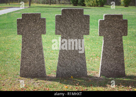 close up image of memorial stone crosses placed in row at graveyard - Stock Photo