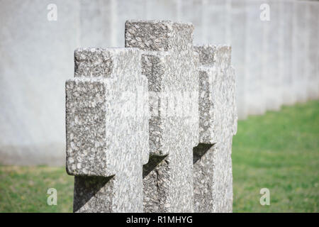 close up view of old memorial headstones placed in row at cemetery - Stock Photo