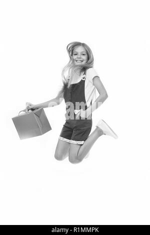 Finally bought it. Girl cute teenager carries shopping bag while jumping. Sale benefits. Kid bought clothing summer sale. Seasonal sale concept. Girls absolutely fond of shopping. - Stock Photo