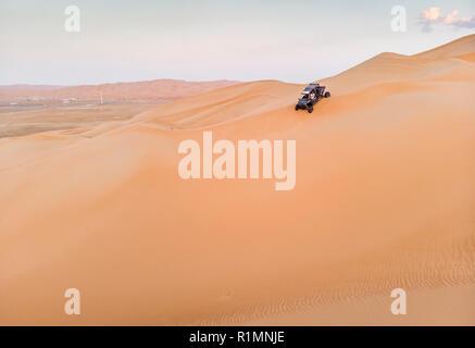 aerial view of a dune buggy in Liwa desert in Abu Dhabi - Stock Photo