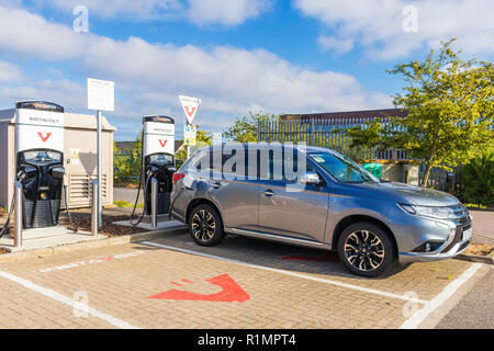 Mitsubishi Outlander PHEV charging at an Instavolt car charging unit electric car charging point hybrid car charging England UK GB Europe - Stock Photo