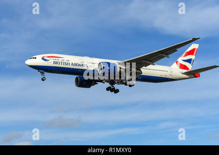 LONDON, ENGLAND - NOVEMBER 2018: British Airways Boeing 777 long haul airliner on final approach to land at London Heathrow Airport. - Stock Photo