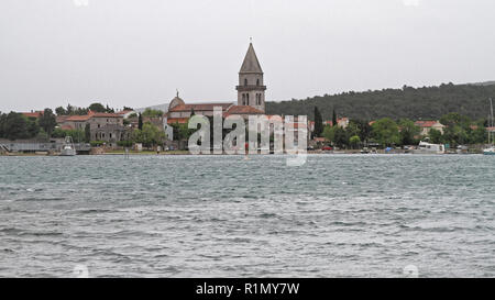 Osor, Croatia - May 15, 2010: Church Tower and Channel Bridge in Osor at Island Cres, Croatia. - Stock Photo