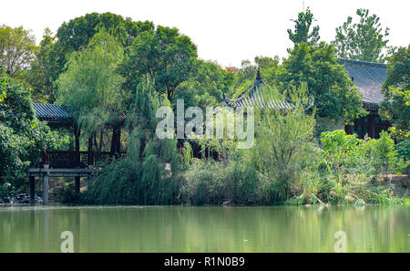 Chinese classical garden. Taken in the historical Chinese town. and the chinese building among the park. - Stock Photo