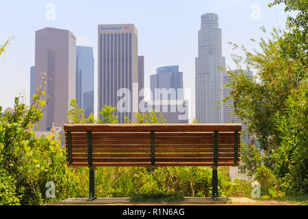 Los Angeles, California, USA - May 30, 2017: A park bench with a spectacular view of Downtown Los Angeles. - Stock Photo