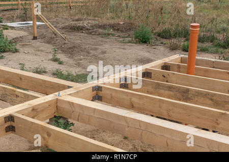 Housing frame assembly. Installation of residential building base of a-type frame house. - Stock Photo