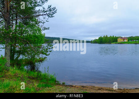 View of countryside and lake Hyypionjarvi in Lapland, Finland - Stock Photo