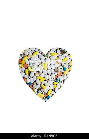 colored pills for treating diseases and addiction in the form of the heart - Stock Photo