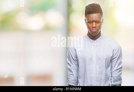Young african american man over isolated background depressed and worry for distress, crying angry and afraid. Sad expression. - Stock Photo