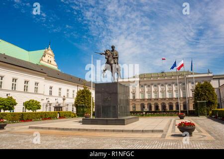 Warsaw, Poland - May 5, 2018: Equestrian statue of Prince Jozef Antoni Poniatowski in front of Presidential Palace on Krakowskie Przedmiescie street. - Stock Photo