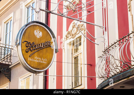 Bad Ischl, Austria - April 20, 2018: Vintage signboard of famous austrian Zauner Cafe and  Cake Shop. It was founded  in 1832 in Bad Ischl. - Stock Photo