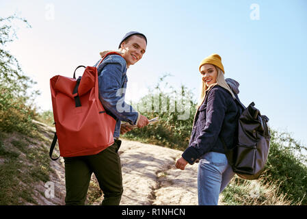 Young couple of travellers are trying to navigate by map in unfamiliar place - Stock Photo
