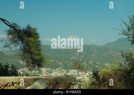 Mountain town panoramic view. landscape with a city between the hills - Stock Photo