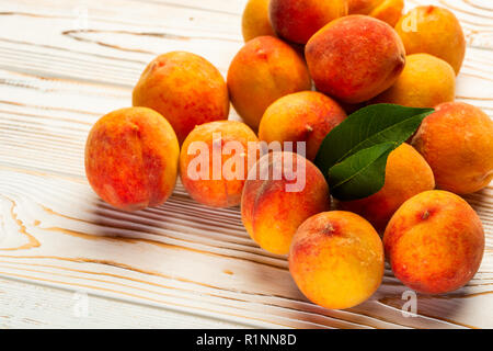 ripe peaches on the table - Stock Photo