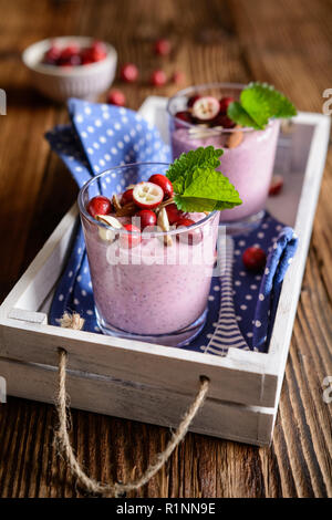 Healthy cranberry chia seeds pudding with sliced almonds - Stock Photo