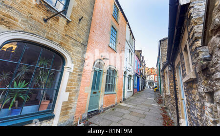 Paul Street, an alleyway off Catherine Hill with unspoilt quaint buildings and shops in the small eastern Somerset town of Frome, south-west England