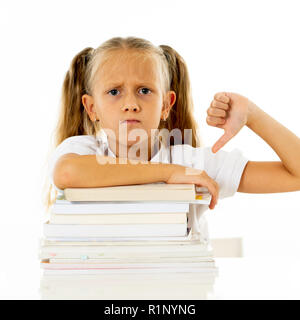 Overwhelmed little girl with a negative attitude towards studies and school after studying too much and having too many homework in children education - Stock Photo