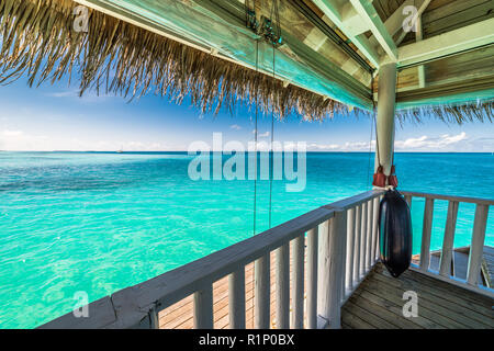 Swimming pool by the beach in Maldives. Luxury travel backgrund in mMaldives island. Blue sea and sky view - Stock Photo