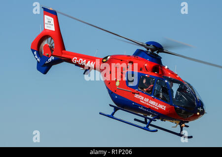 Devon Air Ambulance Eurocopter EC135 G-DAAN flying with space for copy. Helimed emergency helicopter - Stock Photo