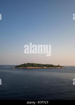 Island Host on Adriatic sea near island Vis in Croatia on sunny morning - Stock Photo