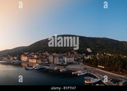 Vis, Croatia - September 16, 2018: Panorama of city Vis and harbor on island at sunrise - Stock Photo