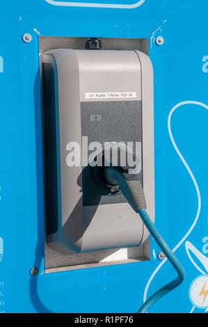 Electric car charging station photographed in Neustift, Stubai, Tyrol, Austria - Stock Photo